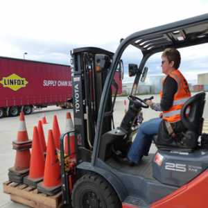 Woman on forklift